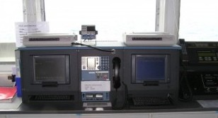 GMDSS station showing Inmarsat comms, VHF, and printers